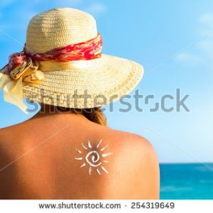 stock-photo-suntan-lotion-woman-with-sunscreen-solar-cream-over-ocean-background-254319649